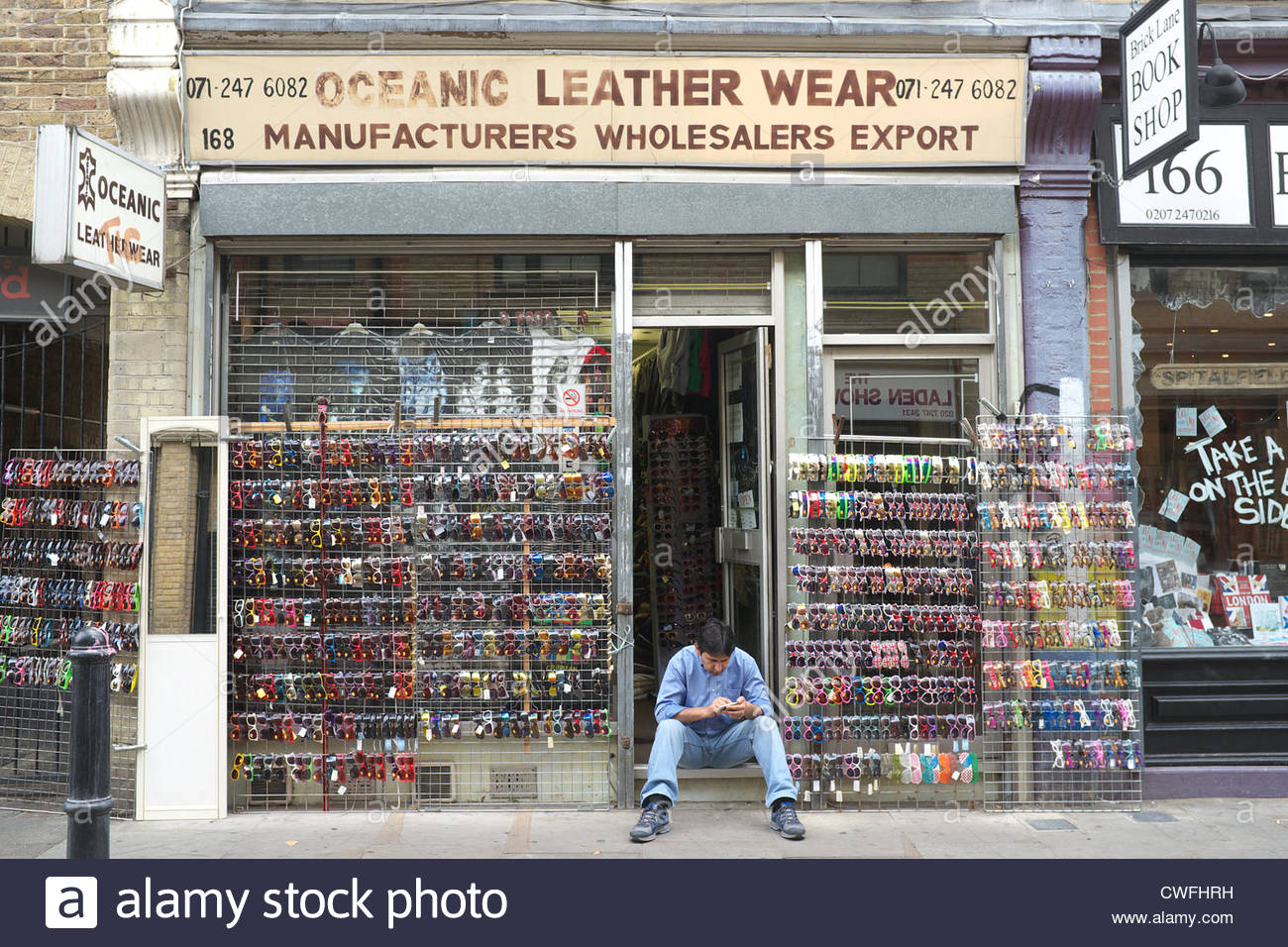 Shop in Brick Lane, selling sunglasses. London, UK. - Stock Image