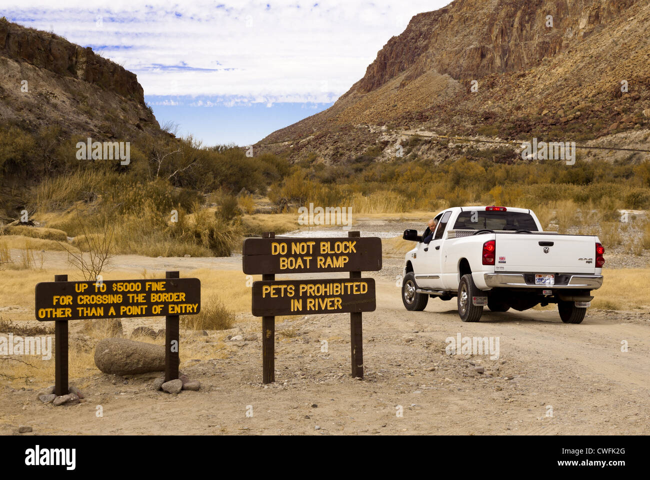 Man in white dodge pick-up truck heads towards the boat ramp and US-Mexico border near Redford, Texas, USA on the - Stock Image