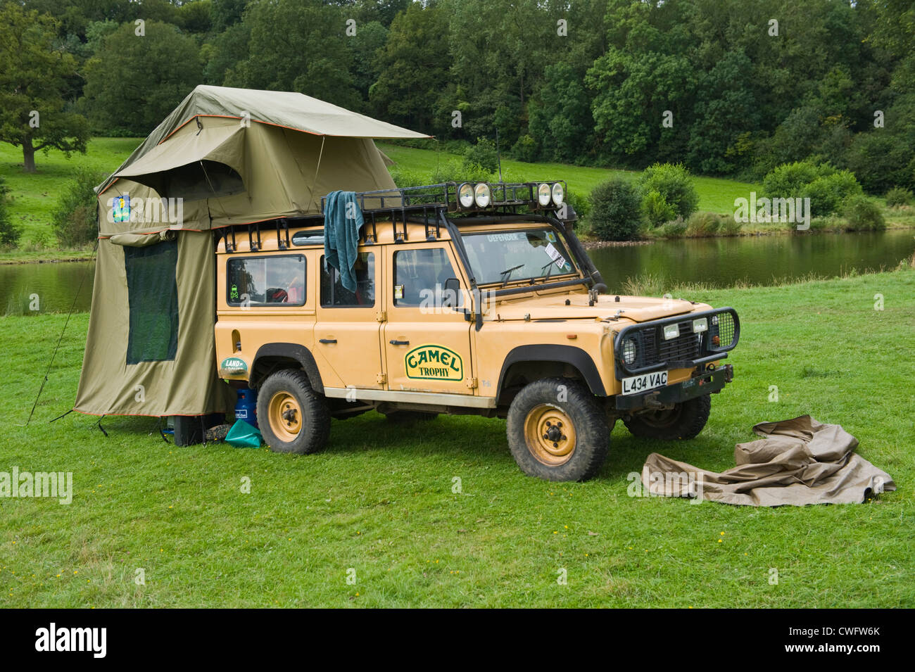 Camel Trophy Land Rover Defender 110 Camping At Lakeside In Stock Photo 50136203 Alamy