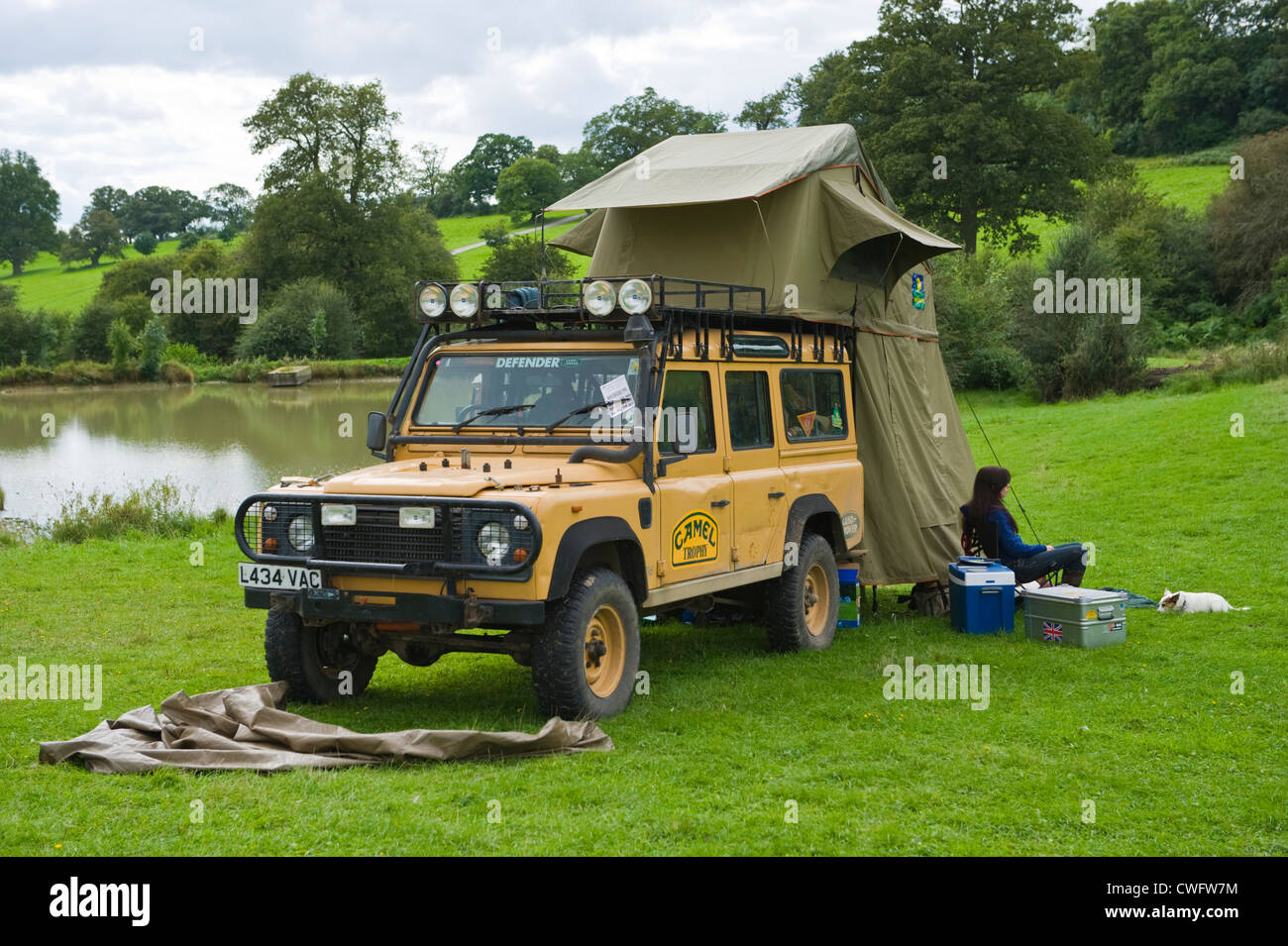 Camel Trophy Land Rover Defender 110 Camping At Lakeside In Stock Photo 50136232 Alamy