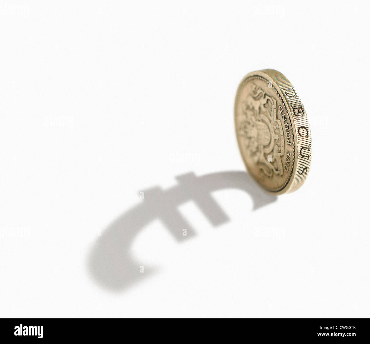 Pund coin casting a shadow of the euro symbol. Stock Photo