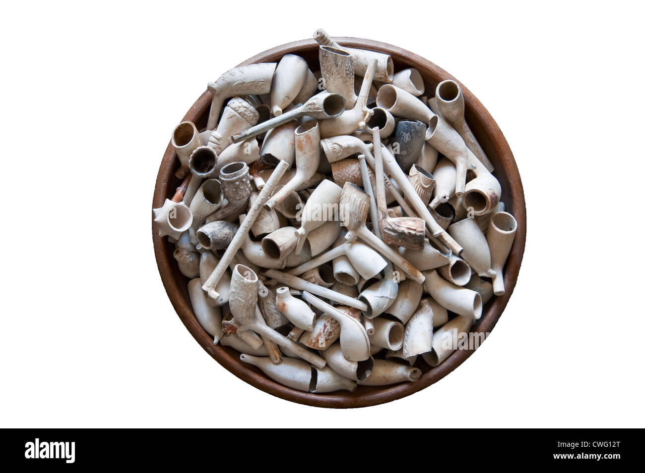 Clay tobacco pipes collected from the mud of the River Thames in London - Stock Image