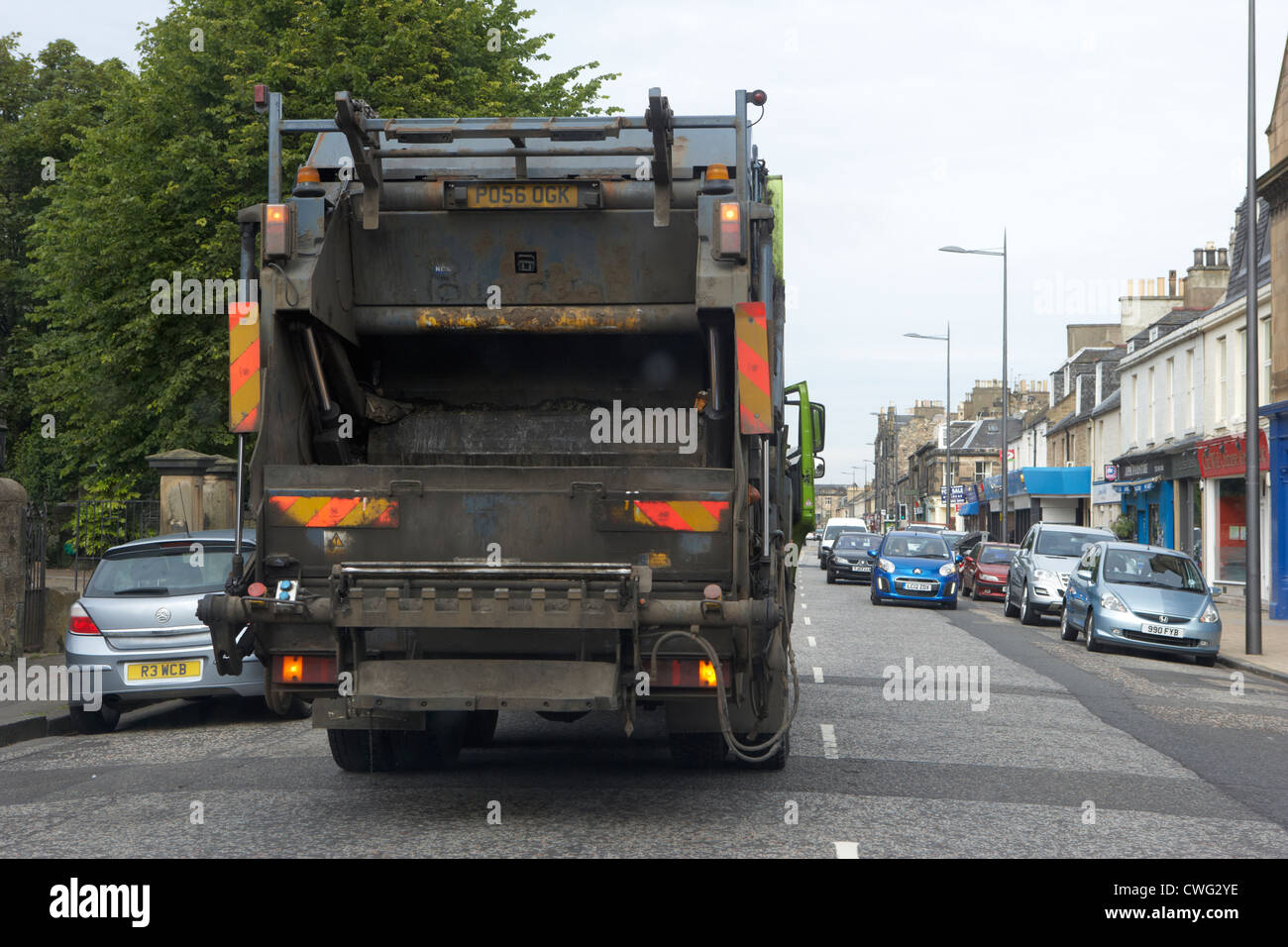 private company bin lorry double parked in the middle of the street in edinburgh, scotland, uk, united kingdom - Stock Image