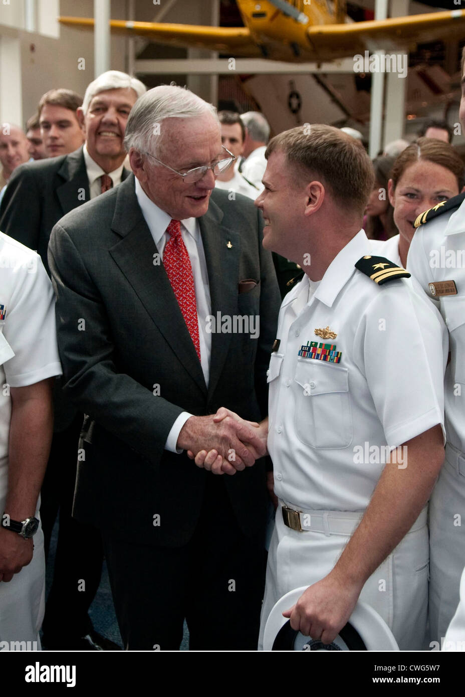 Former astronaut Neil Armstrong is congratulated by Lt. Gavin Clough, from San Diego, Calif. after Armstrong's - Stock Image
