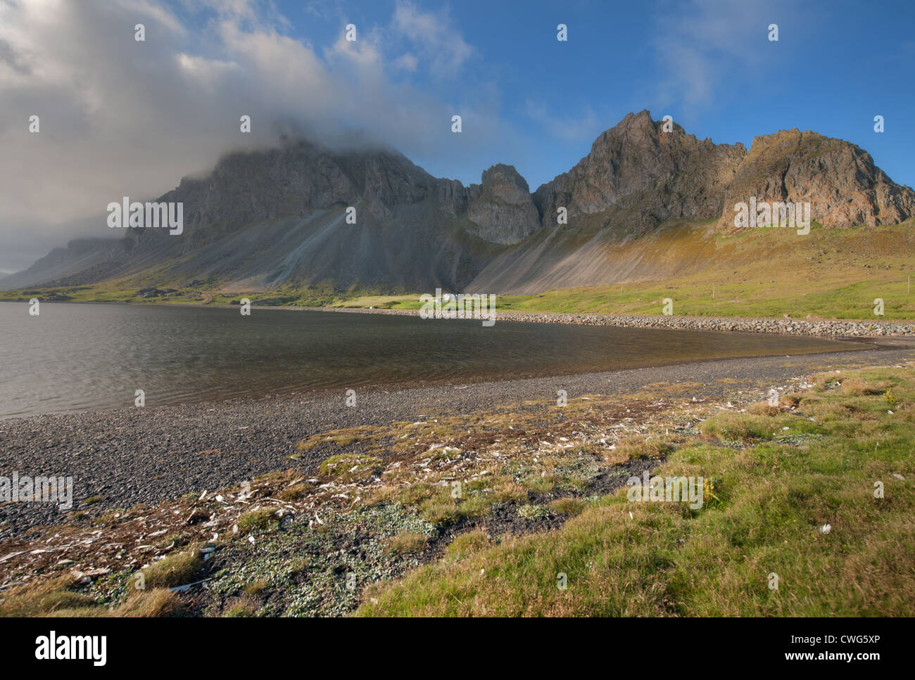 Clouds roll down from a mountain on Iceland's south coast near Höfn Stock Photo