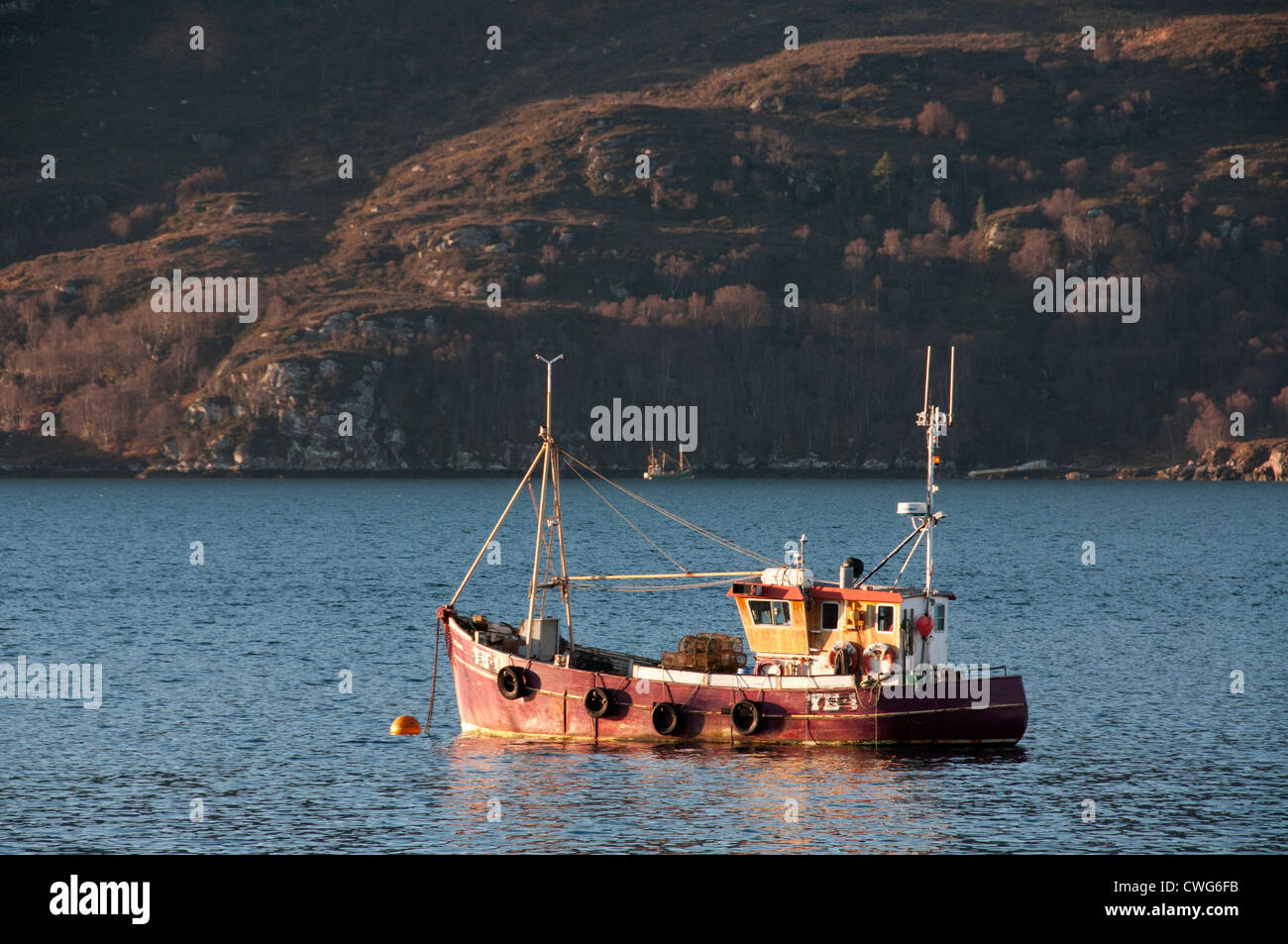 a old fishing boat on loch broom ullapool wester ross  west highlands of scotland - Stock Image