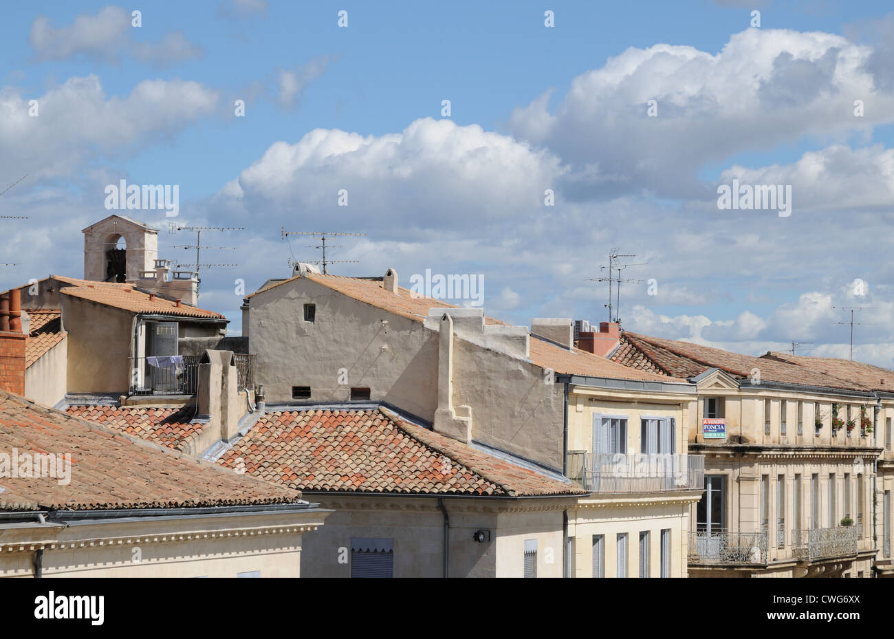 Terra cotta tiled roofs and tV television aerials Nimes France seen from Carree d'Art Museum - Stock Image