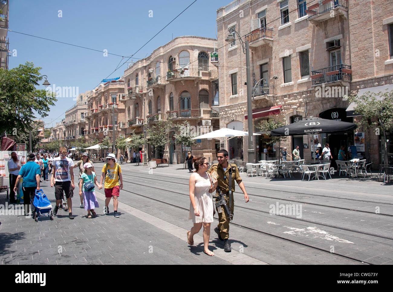 An Israeli soldier and a female walk down Jaffa Road, Jerusalem, Israel - Stock Image