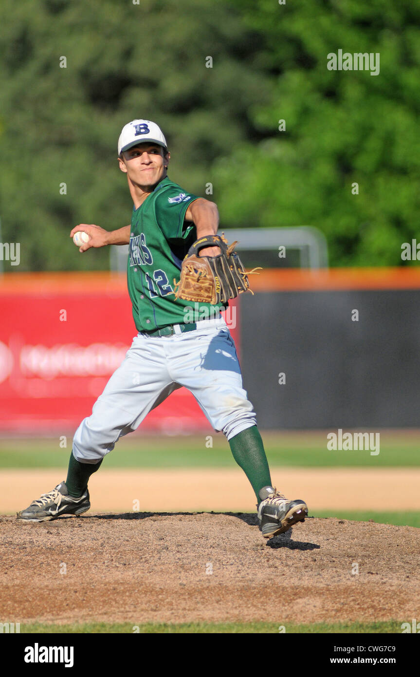 Baseball Pitcher pitches high school sectional playoff game. Illinois, USA. - Stock Image
