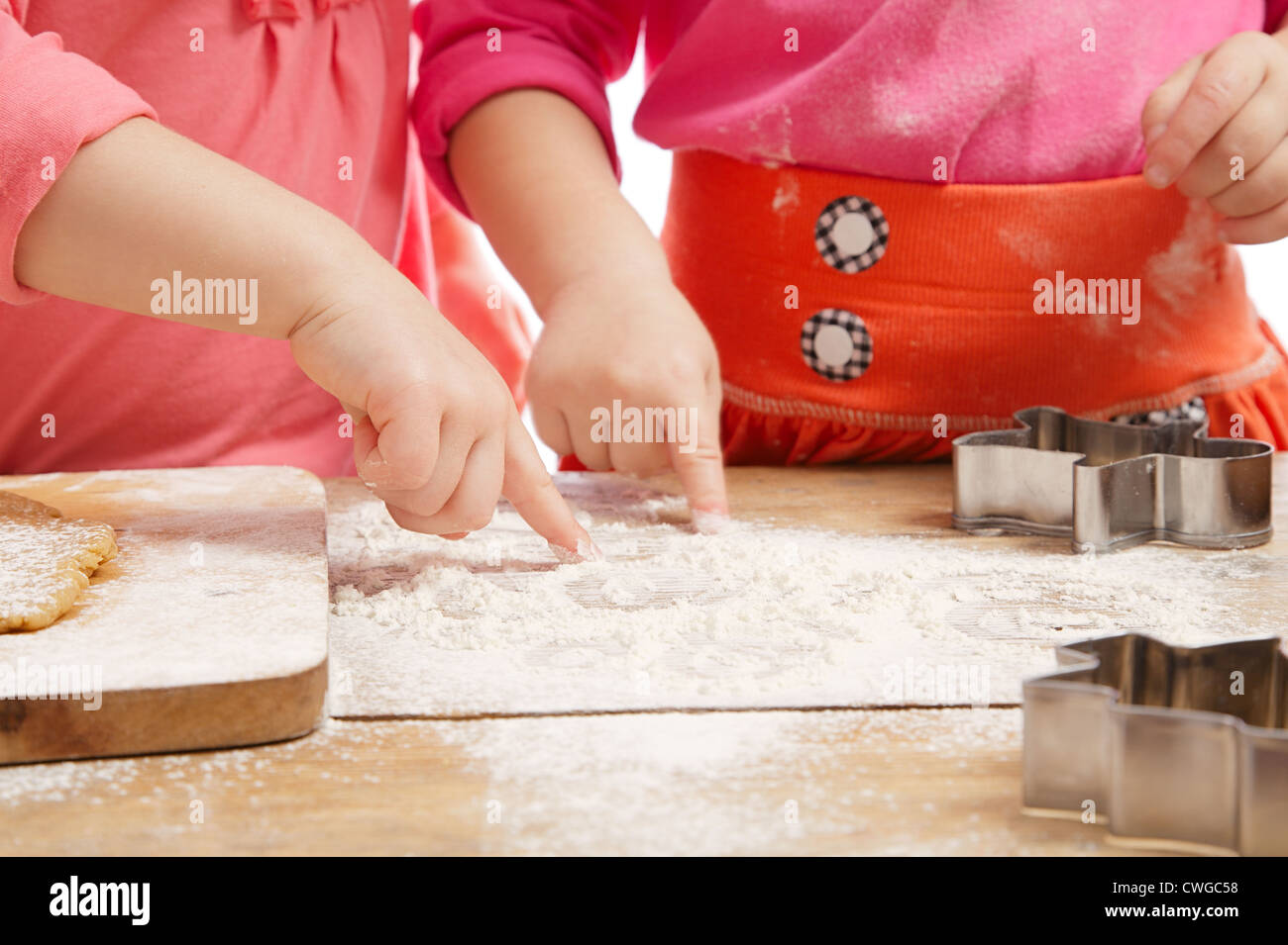 little girls baking and having fun, hands only - Stock Image