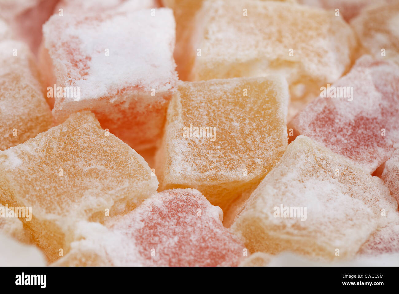 turkish sweet delight, rose and yellow, dusted with caster sugar - Stock Image