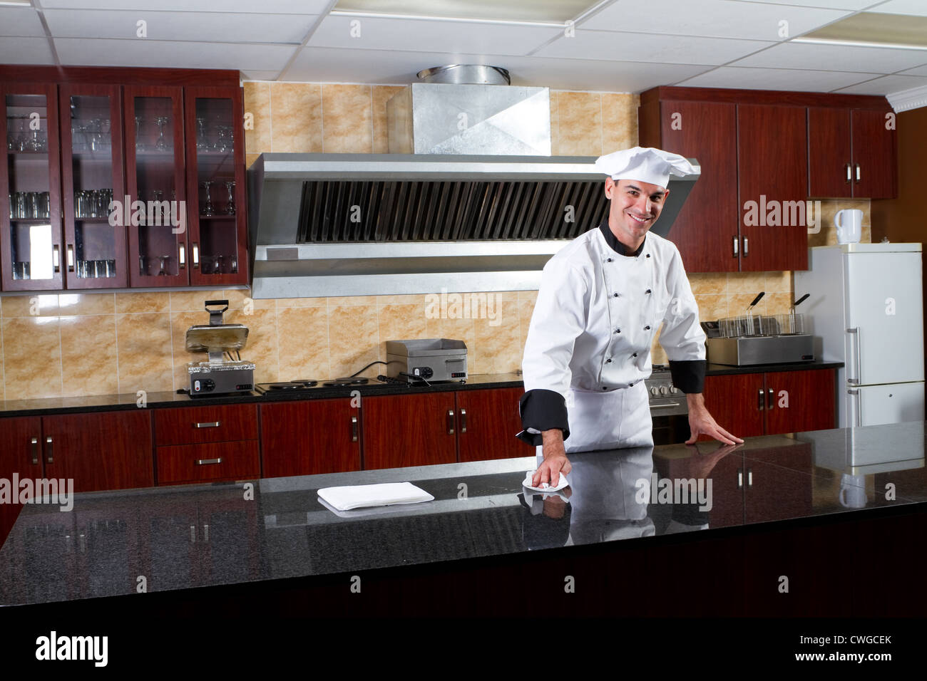 professional chef cleaning industrial kitchen - Stock Image