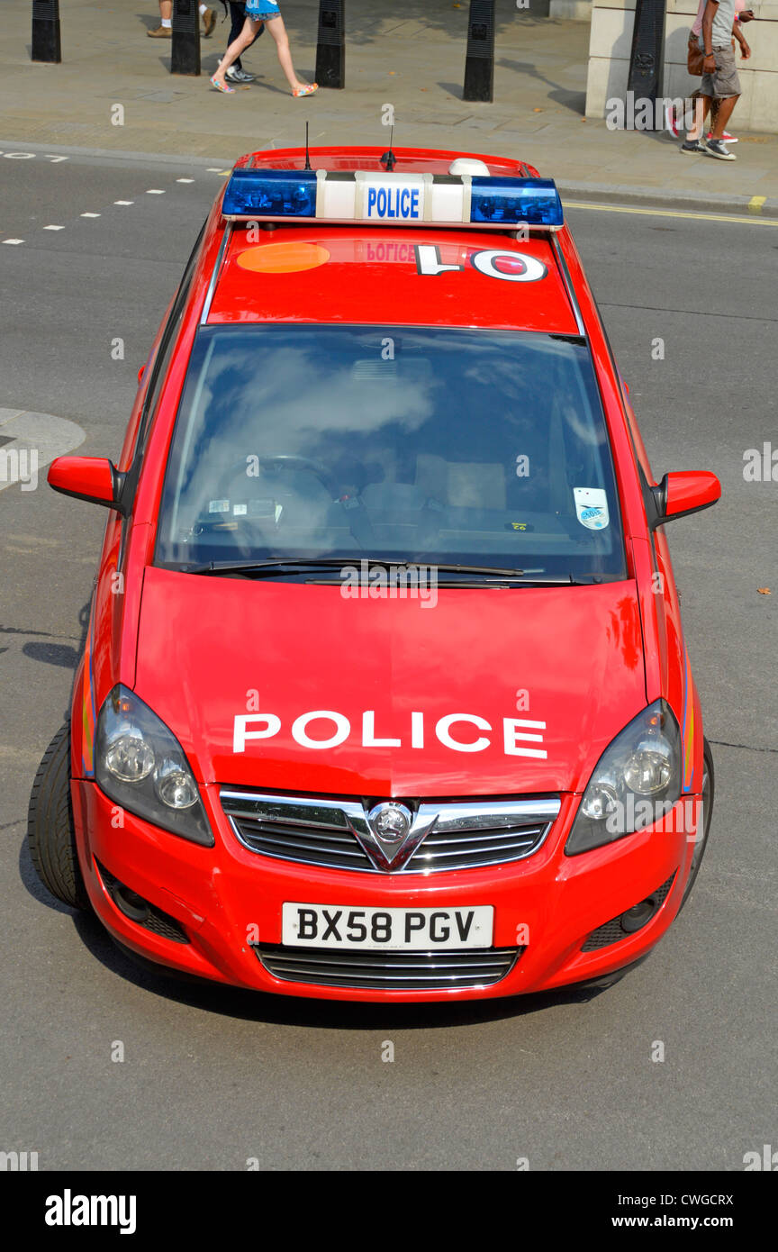 Red car of the parliamentary and Diplomatic Protection branch of London Metropolitan Police parked up in Whitehall - Stock Image