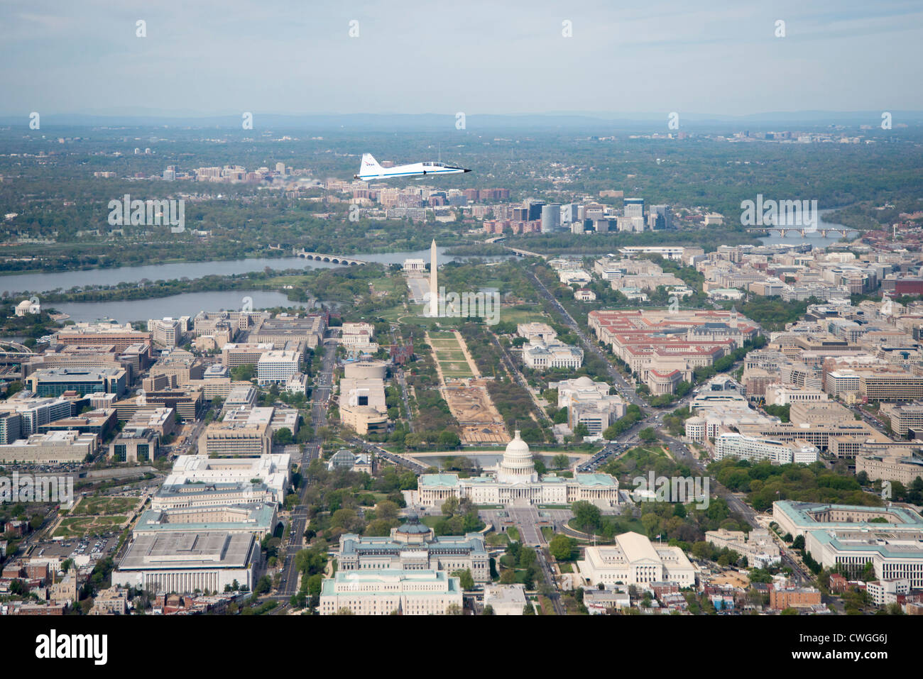 A NASA T-38 training jet is seen as it flies over Washington, DC, April 5, 2012. NASA, in cooperation with the Federal - Stock Image