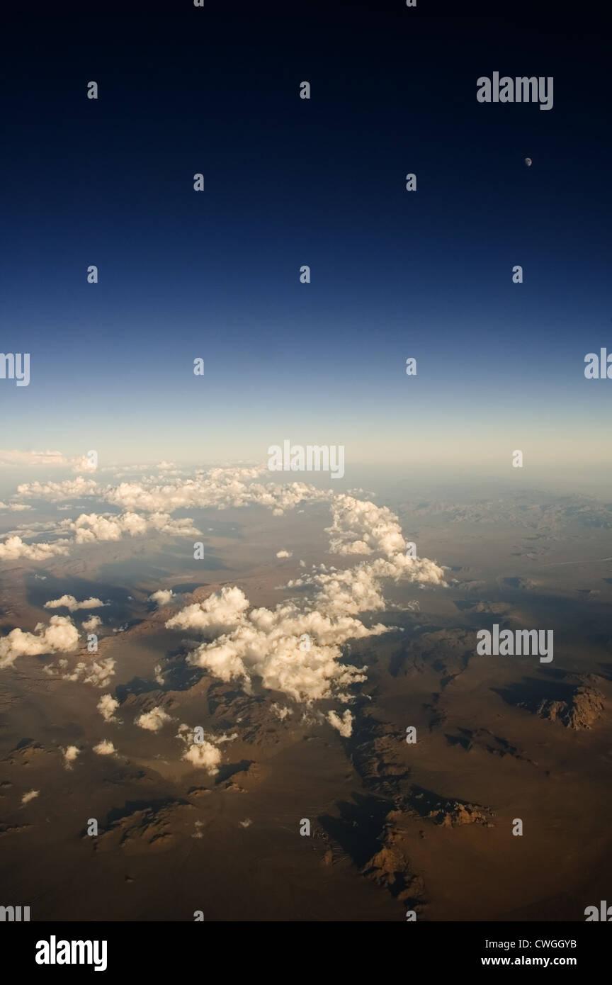 Desert Moon & Cloud Trail Stock Photo