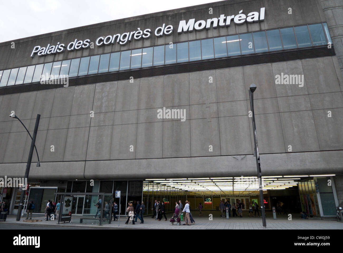 Palais des congres de Montreal sign and pedestrians passing building on street outside exterior of concrete building Stock Photo