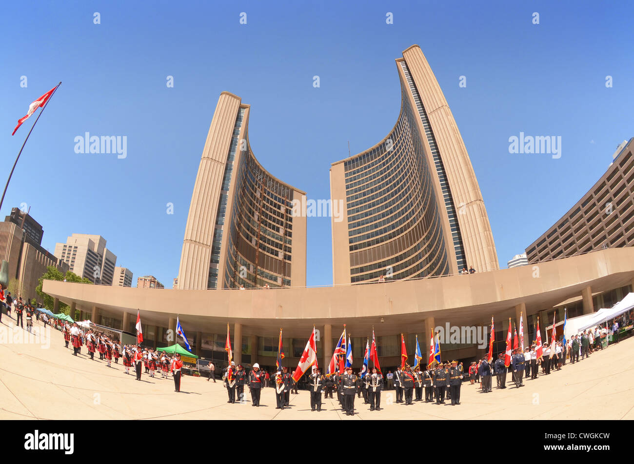 Canadian armed Forces parading beneath The City Hall, Toronto, Canada, celebrating 72nd. Anniversary of the Battle - Stock Image