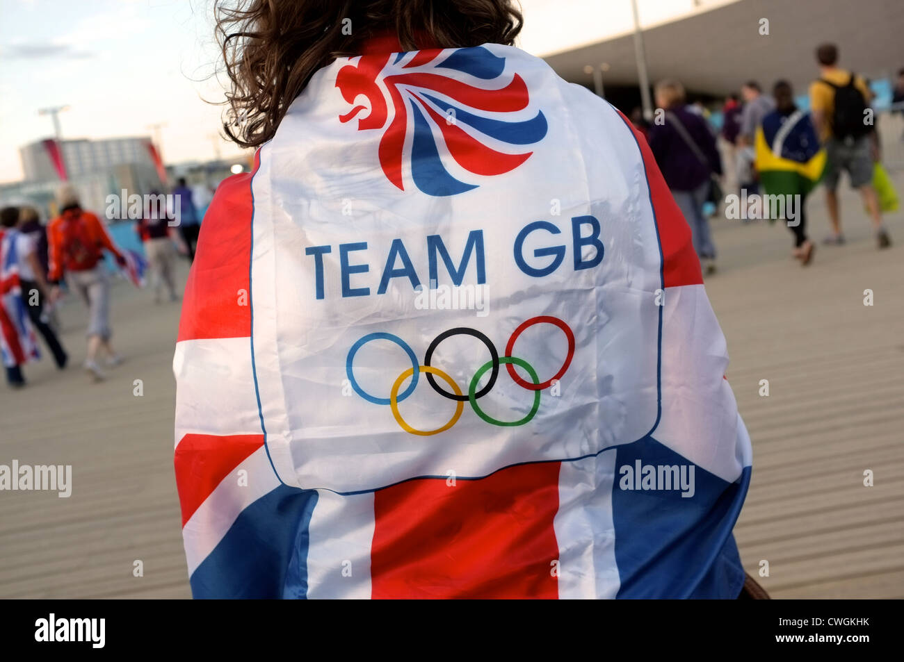 Supporter wrapped in Team GB flag - Stock Image