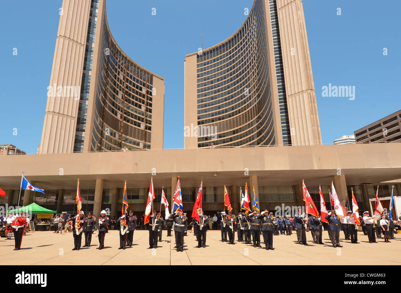 Canadian armed Forces parading beneath The City Hall, Toronto, Canada, celebrating 72nd. Anniversary of the Battle Stock Photo