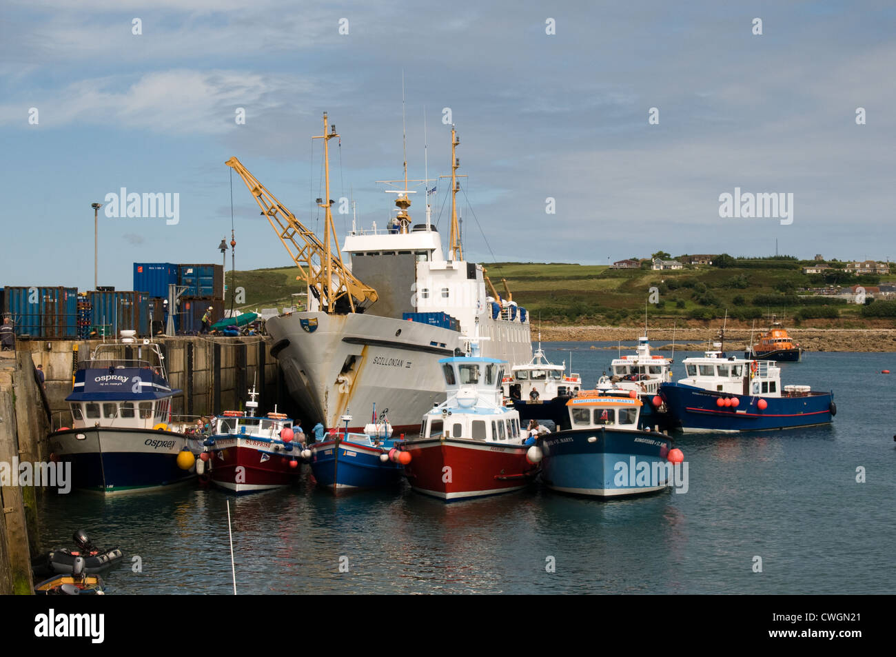 The Scillonian III off loads cargo at the Quay in Hugh Town harbor, St Mary's, Isle of Scilly. Off island ferries - Stock Image