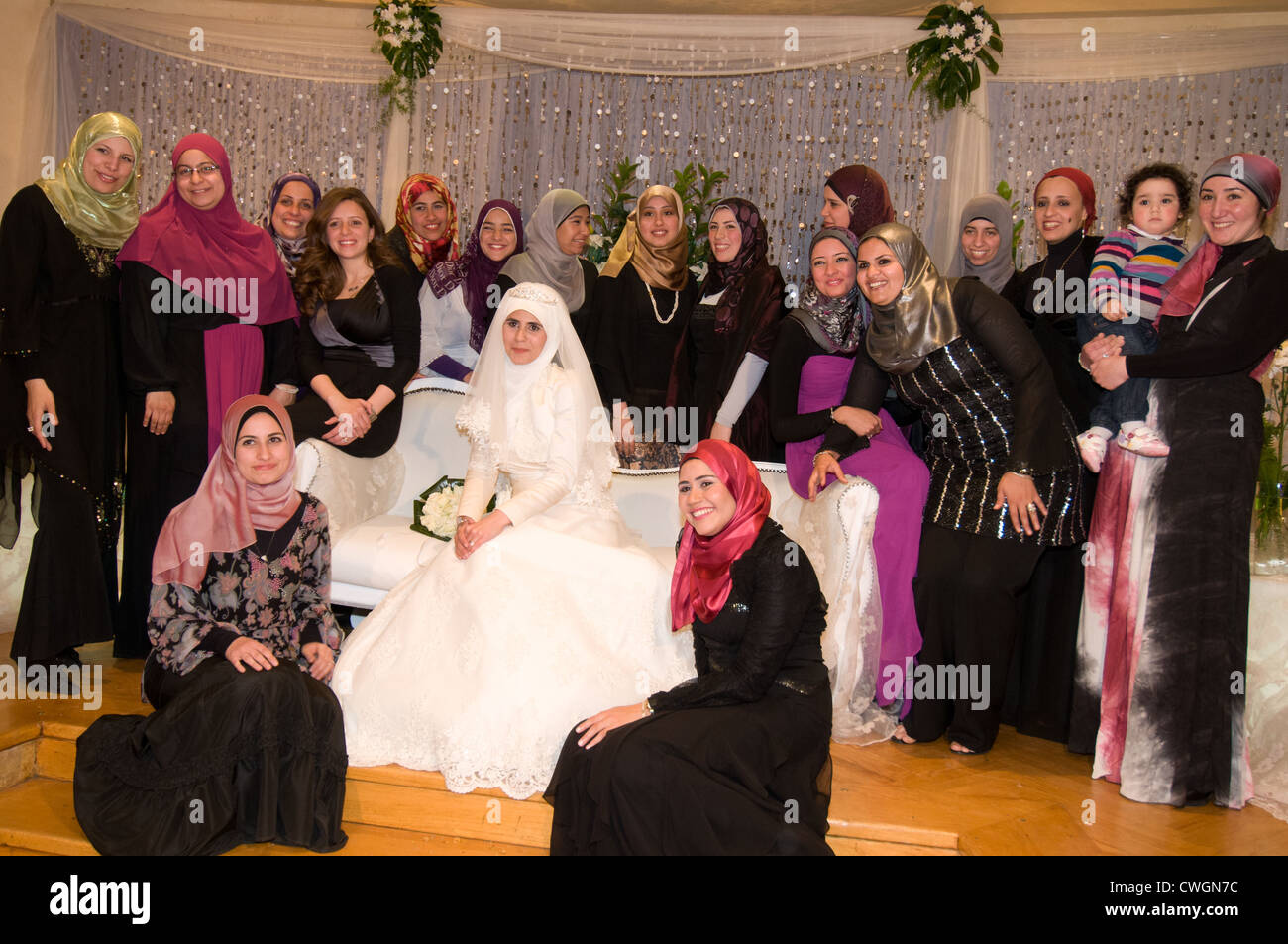 Female friends and relatives with bride at wedding cairo egypt stock female friends and relatives with bride at wedding cairo egypt junglespirit Images