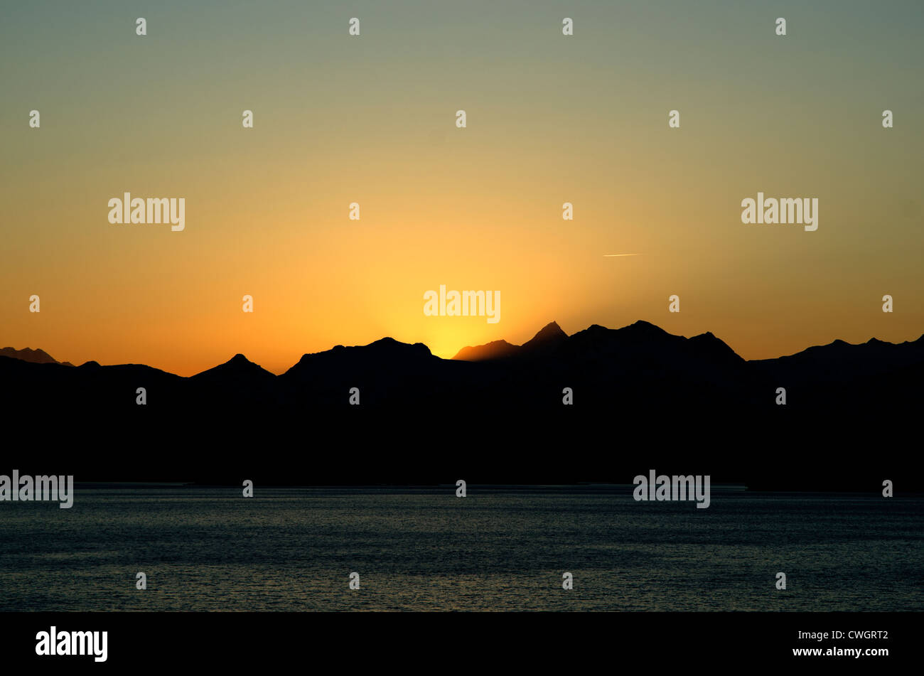 Sun sets Behind the Chugach Mountains in Alaska, USA - Stock Image