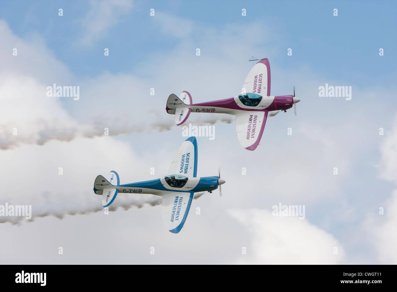 Silence Twisters, reg G-SWIP and G-ZWIP, aerobatic team sponsored by Scottish Widows - Stock Image