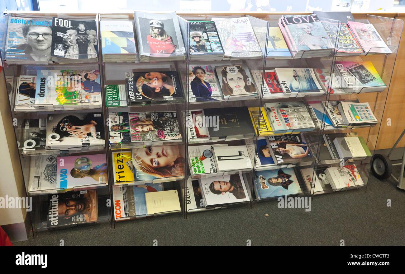 Packed magazine rack, London, England, UK Stock Photo