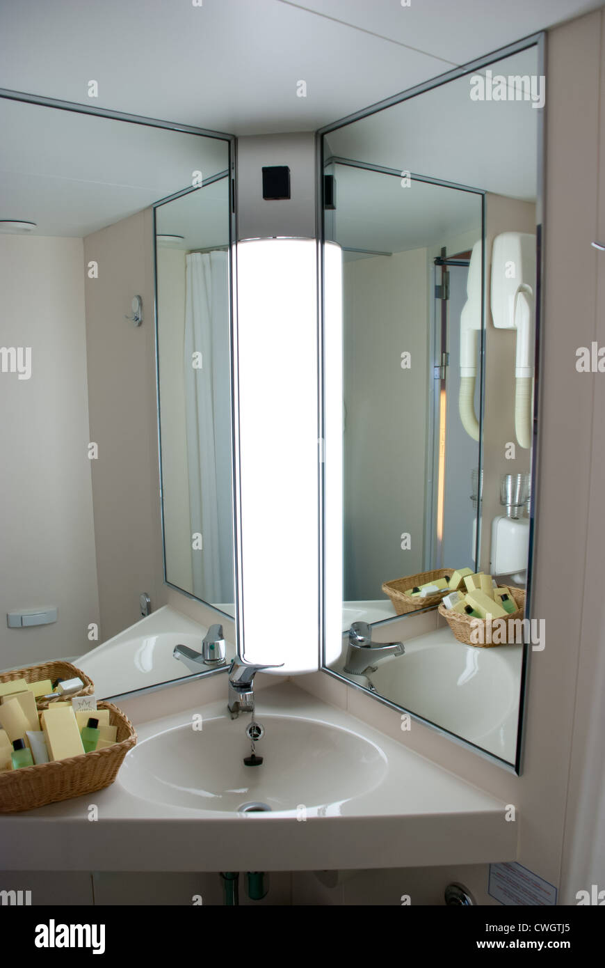 Compact Sink And Mirrors Of Cruise Ship Bathroom Stock Photo