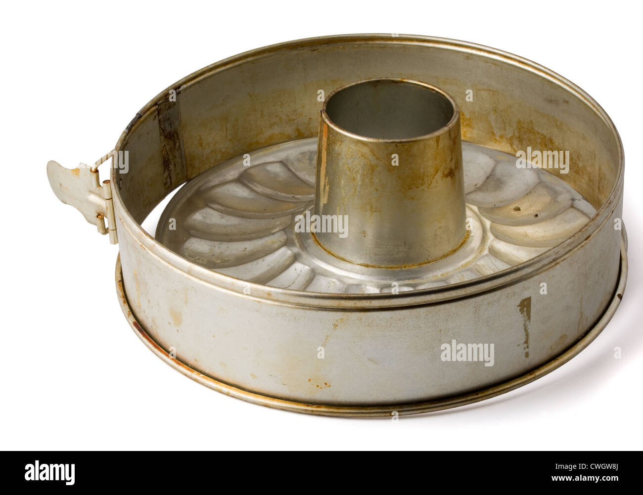 Old fluted tube baking pan isolated on white - Stock Image
