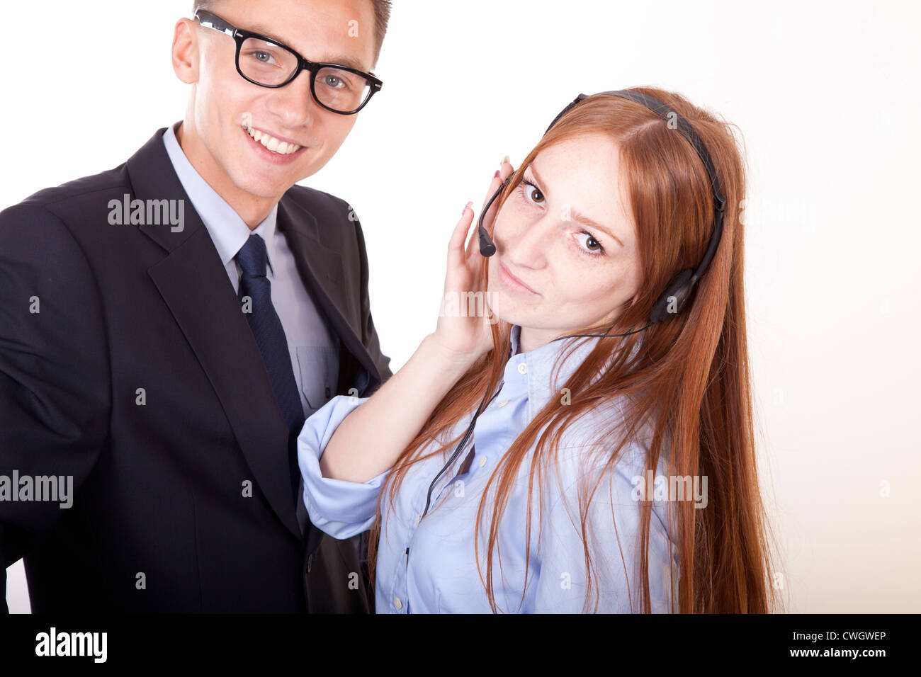 Young receptionists working and smiling. - Stock Image