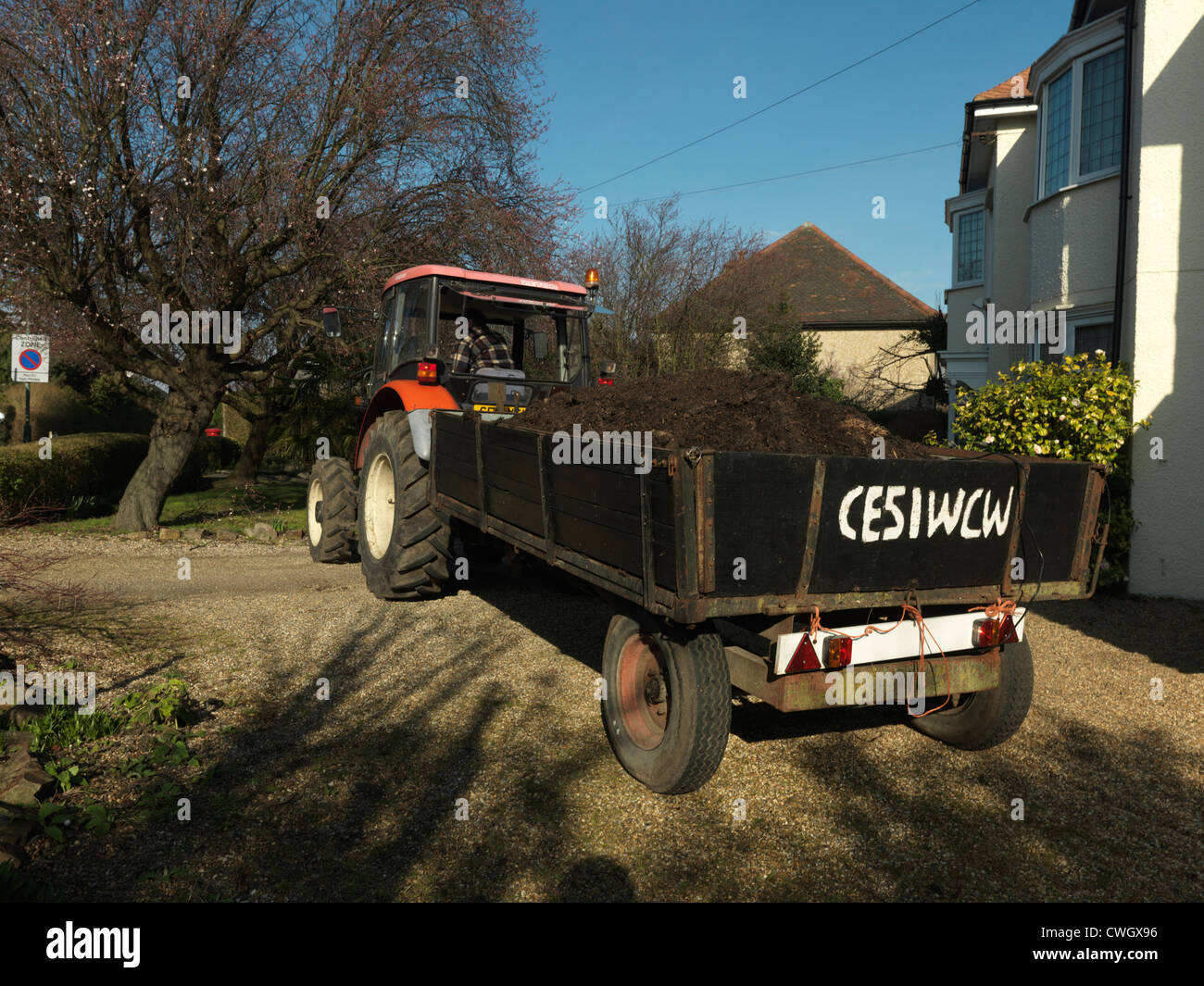 Tractor Delivering Manure For Garden Surrey England Stock Photo