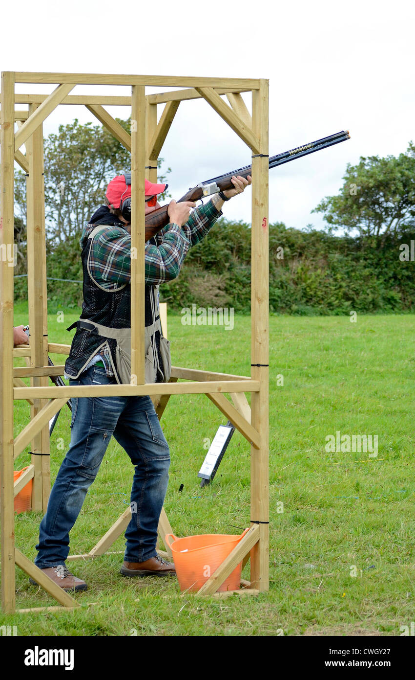 A male competitor in a Clay Pigeon shooting competition at a country fair near Camborne in Cornwall, UK - Stock Image