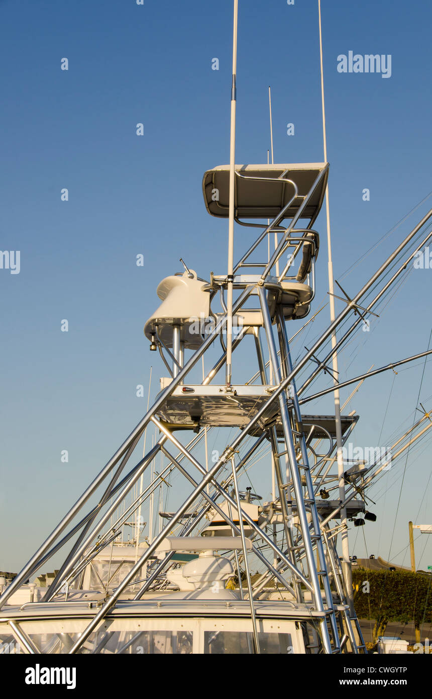 Tuna towers on a line of offshore deep sea sport-fishing boats - Stock Image