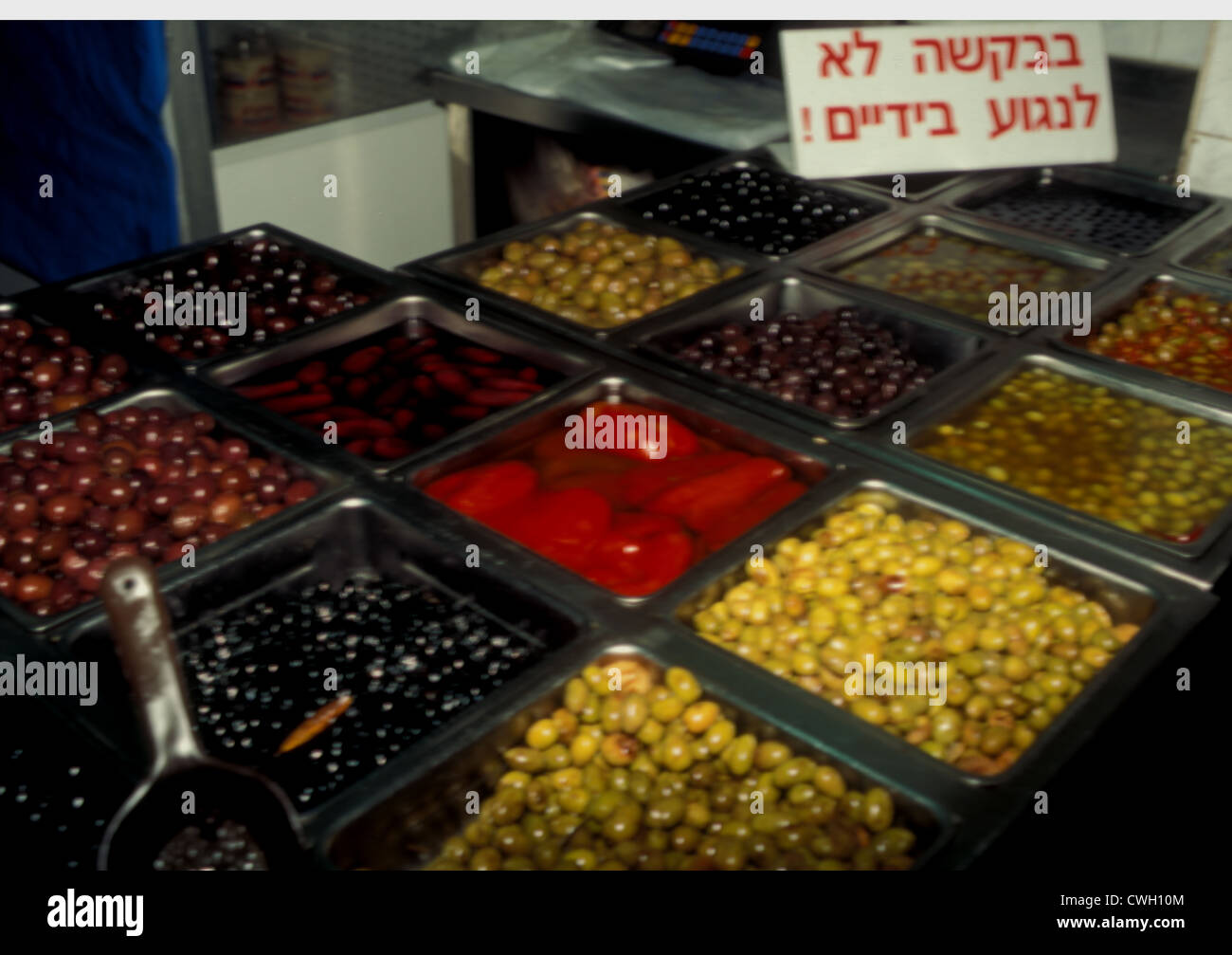 Preserved olives and peppers Carmel Street market, Tel Aviv, Israel - Stock Image