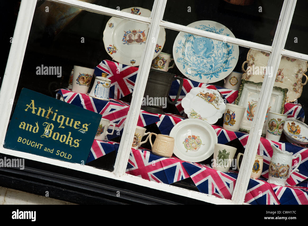 Antique shop with Royal memorabilia and union jacks in the window. Presteigne,  Powys, Wales Stock Photo