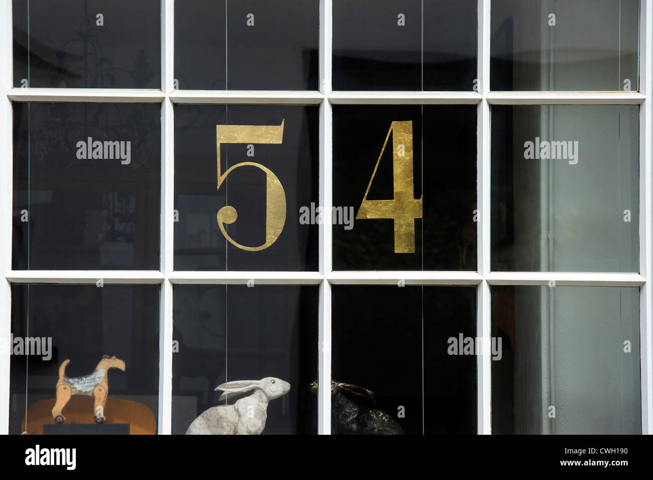 Gilded Number 54 in a shop window. Kington. Herefordshire, England - Stock Image