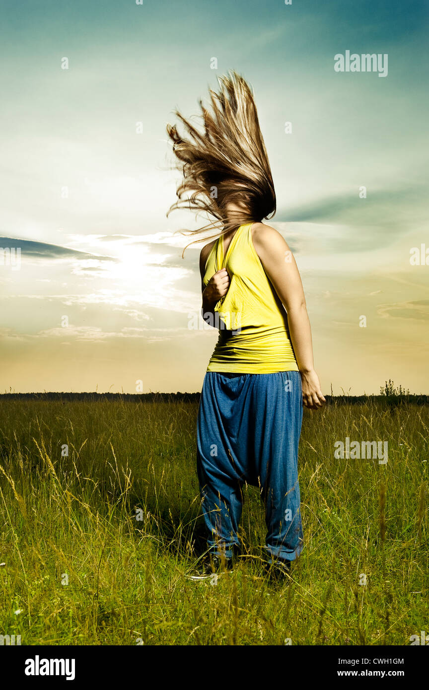 young woman,individuality,uniqueness,fluttering hair - Stock Image