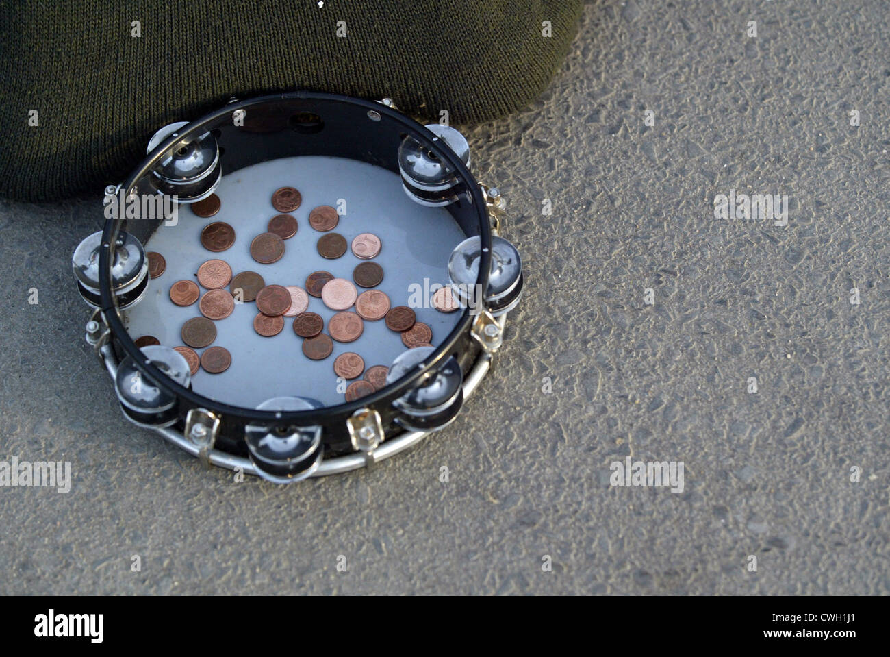 Berlin, coins in a tambourine - Stock Image