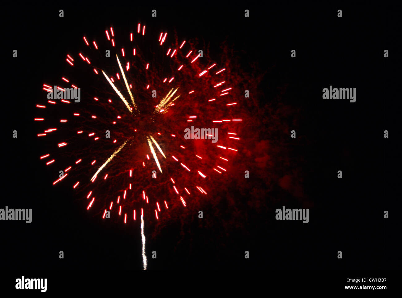 Single Red Firework Explosion Stock Photo