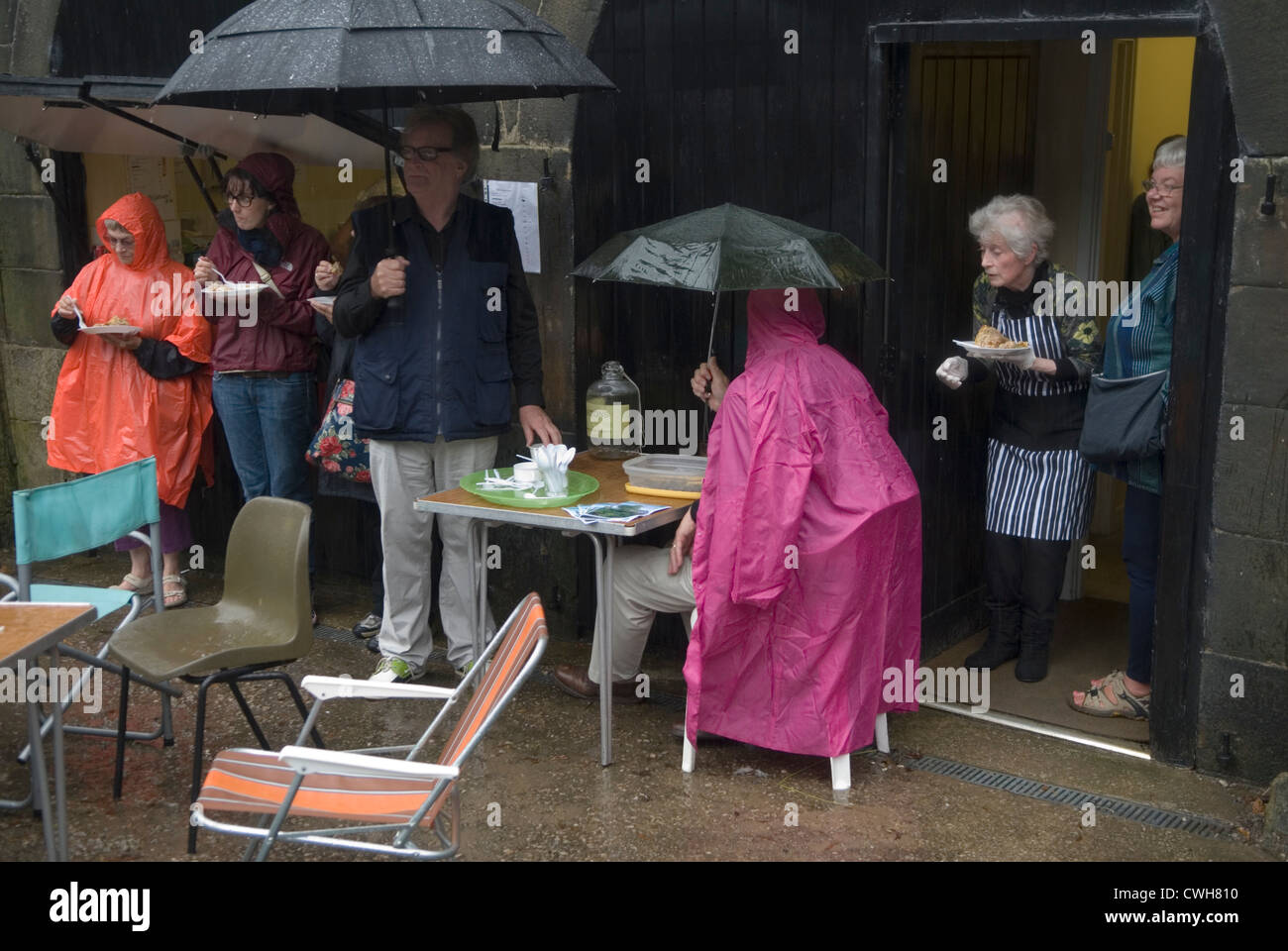 Rain uk raining England August bank holiday rained off event English bad weather HOMER SYKES - Stock Image