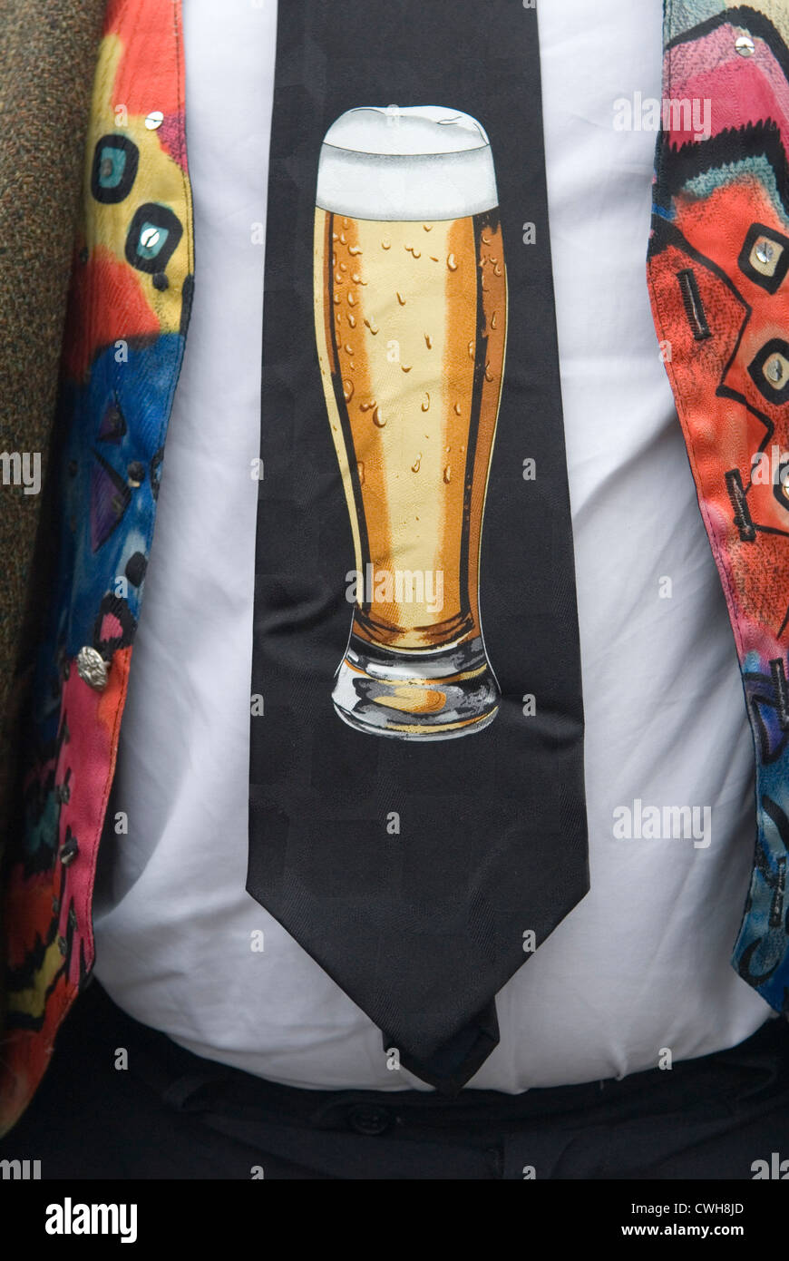 Man wearing a colourful waistcoat, and a tie with a design of a pint of beer  Uk.  HOMER SYKES - Stock Image