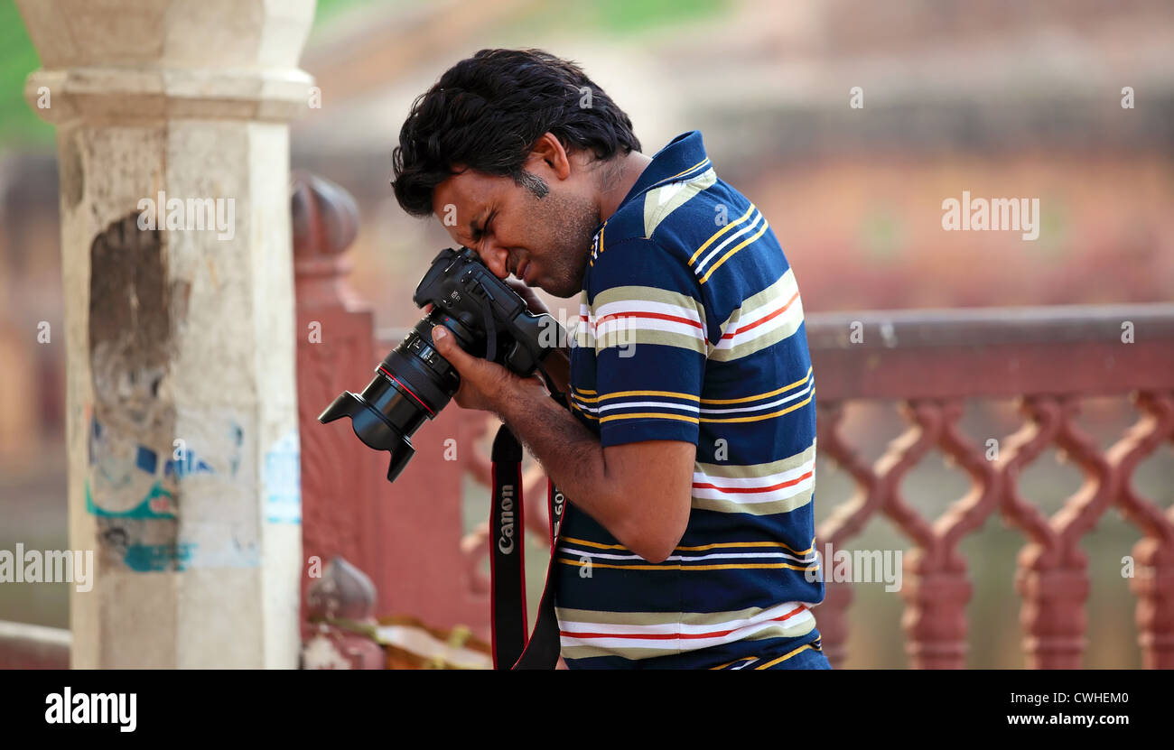 Camera,Lens,Filming,shooting, Photographer,Photo shoot, Photographic themes, Reportage.,Nature,Adventure.SLR camera,Photo - Stock Image