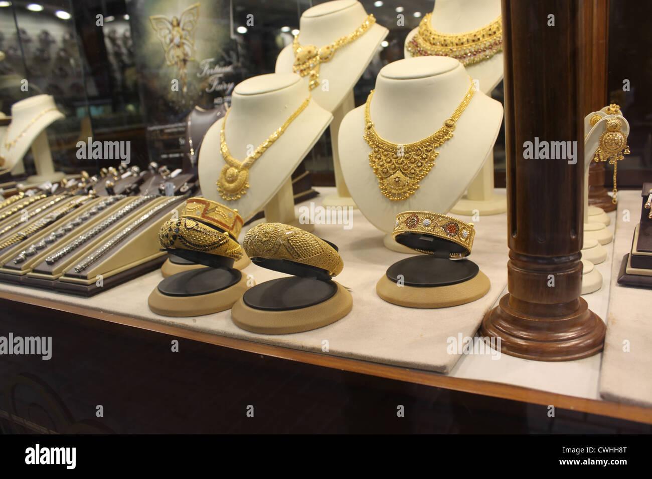 Emirates. Dubai. Gold jewelery in a shop window - Stock Image