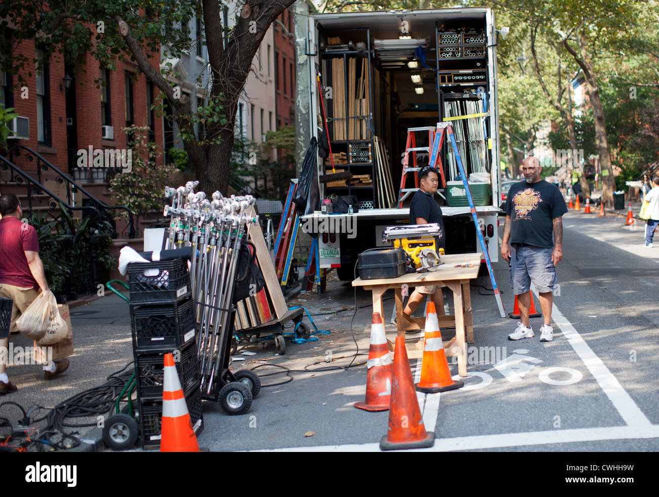 Workers help construct a movie set for 'Zero Hour,' an ABC-TV drama show filmed in Brooklyn, New York. - Stock Image