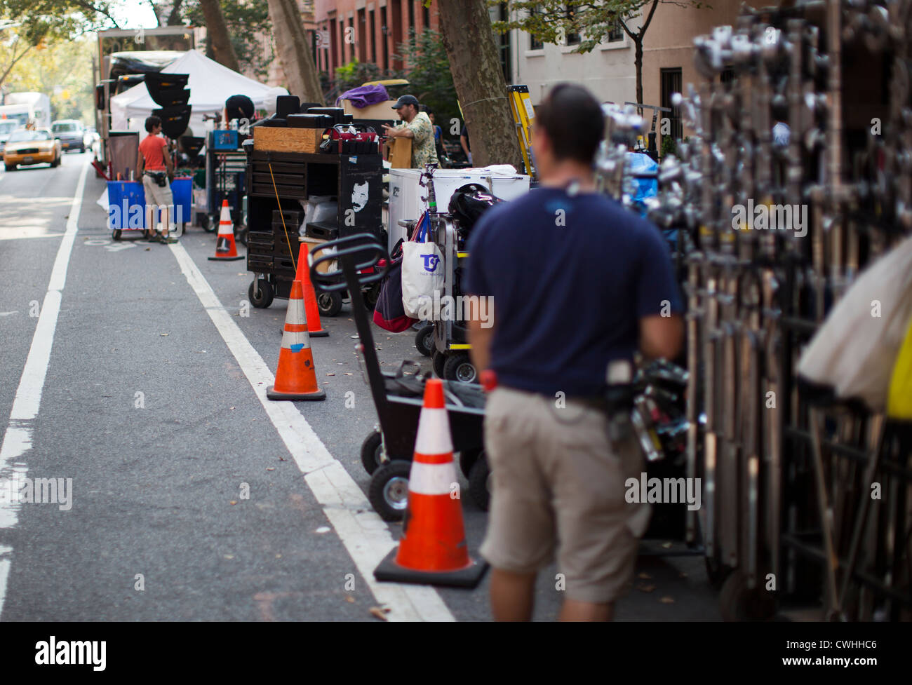 Workers help construct a movie set for 'Zero Hour,' an ABC-TV drama show in Brooklyn Heights, New York. - Stock Image