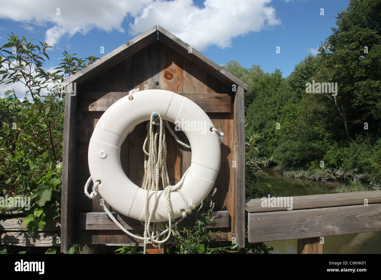 Life saver old style on a bridge over a small river - Stock Image