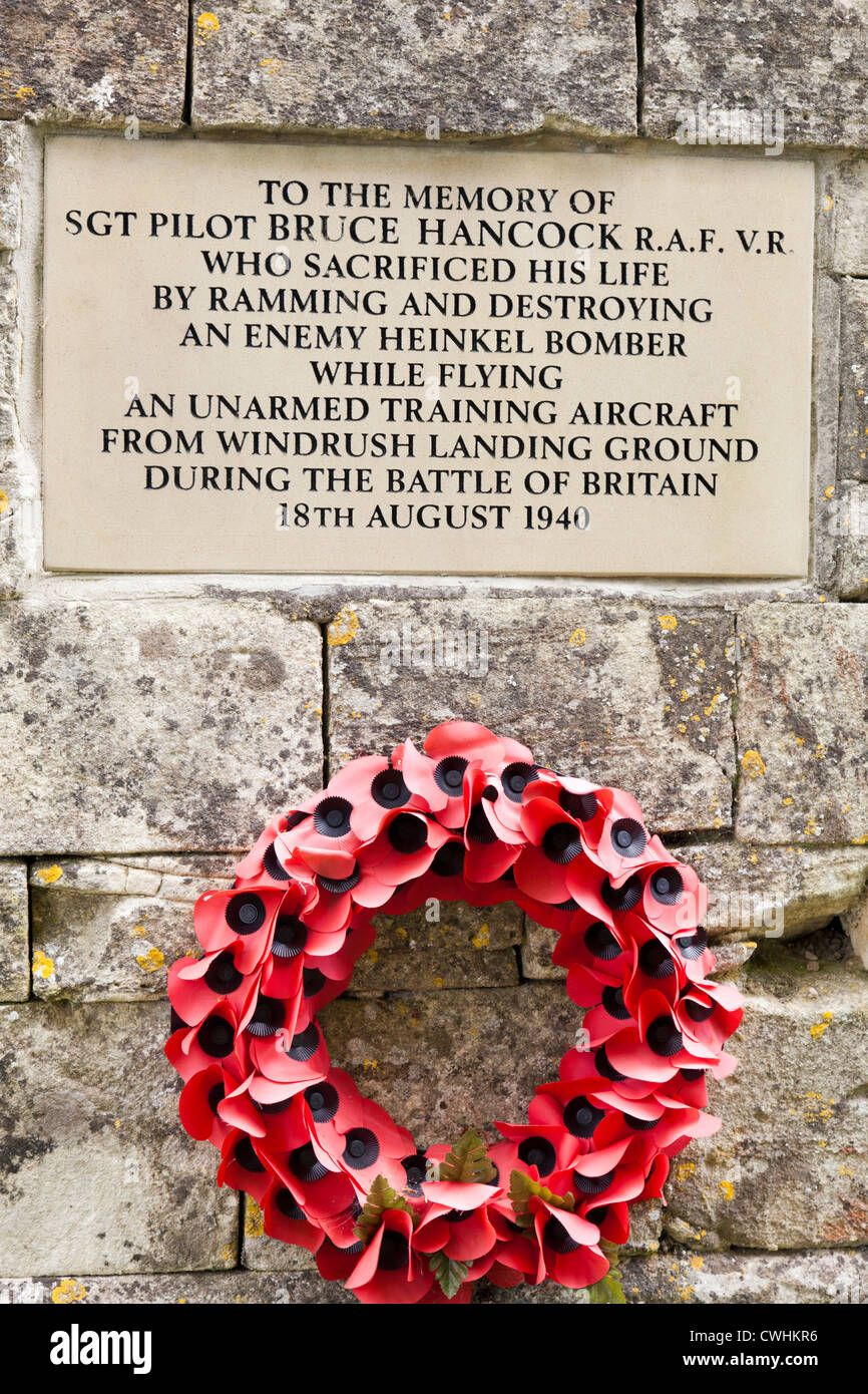 Memorial in the wall of Windrush churchyard, Gloucestershire, UK to a brave RAF pilot in the Second World War - Stock Image