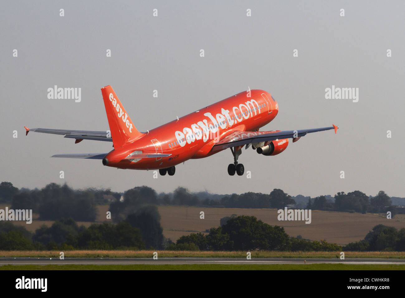Easy Jet Airbus A320-214 climbing after leaving runway - Stock Image