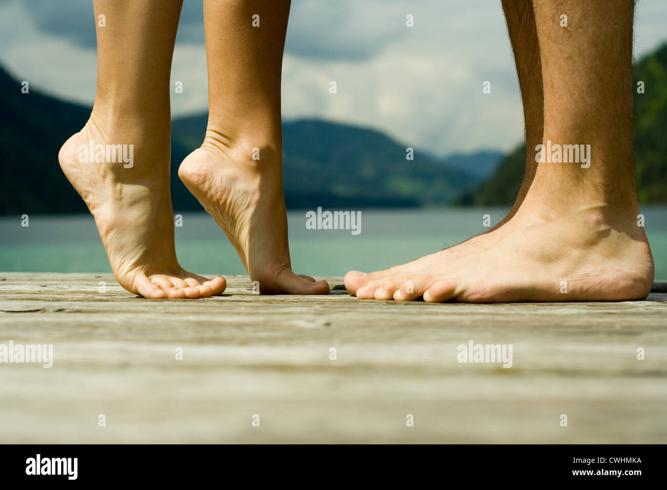 barefoot,feet,stretching,size difference - Stock Image